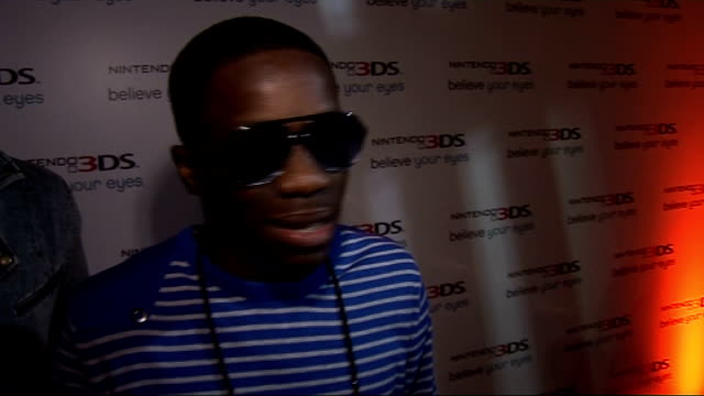 celebrity arrivals tinchy stryder interview sot on his omg face when he found out gaming was going 3d can't repeat it / 3d glasses / his favourite... - 3d glasses stock videos & royalty-free footage