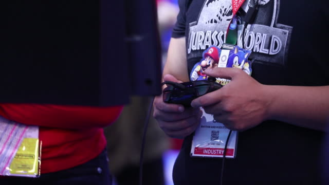 nintendo co pokemon sword and shield display during the e3 electronic entertainment expo in los angeles california us on wednesday jun 12 2019 - gamepad stock videos & royalty-free footage