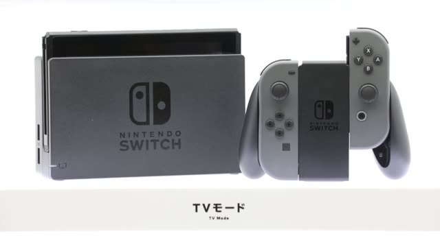 nintendo co's switch videogame console is displayed at an unveiling event in tokyo japan on friday jan 13 2017 shots view of two nintendo switch... - handheld video game stock videos & royalty-free footage