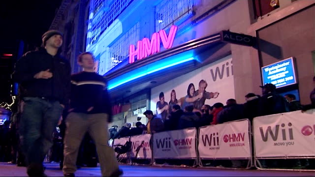 Nintendo games console 'Wii' hits shops EXT / NIGHT People queuing outside HMV store waiting to purchase Nintendo 'Wii' People in queue TRACK