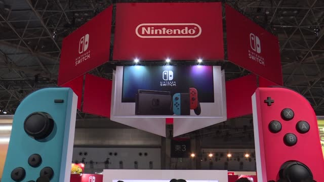 nintendo unveils its new switch game console which works both at home and on the go as it looks to offset disappointing wii u sales and go head to... - launch event stock videos & royalty-free footage