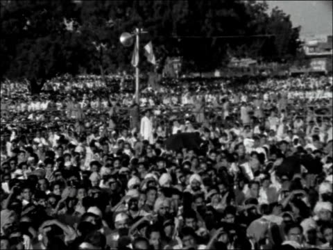 celebrations INDIA New Delhi EXT Indian national flag flying on mast at top of Red Fort / Independence Day ceremony / Crowds / Jawaharlal Nehru...