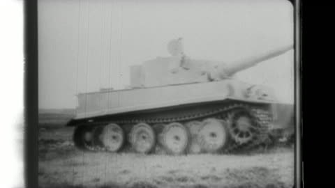 nippon news newsreel shows german tiger tanks drive through a house and destroy target tanks while on the french coast; german gunners setup a... - world war ii stock videos & royalty-free footage