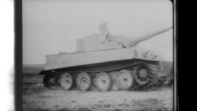 vidéos et rushes de a nippon news newsreel shows german tiger tanks drive through a house and destroy target tanks while on the french coast german gunners setup a... - wehrmacht