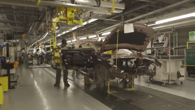 nissan cars being made on production line at the sunderland car plant - production line stock videos & royalty-free footage