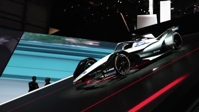 A Nissan Formula E racing car sits on display on the Nissan Motor Co stand at the 88th Geneva International Motor Show in Geneva Switzerland on...