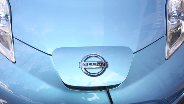 a nissan leaf electric car recharging at en electric car charging point in london, uk - electric vehicle stock videos & royalty-free footage
