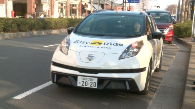 A Nissan Motor Co Leaf electric vehicle used for the 'Easy Ride' robot taxi service jointly developed by Nissan and DeNA Co operates during a test...