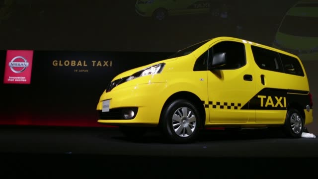 nissan motor co nv200 taxi cab is displayed during a launch event ms the nissan motor co badge is displayed on the company's nv200 taxi cab for... - transportation event stock videos and b-roll footage