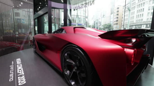 nissan motor co. vehicles stand on display at the company's nissan crossing showroom in the ginza district of tokyo, a day ahead of the general... - kanto region stock videos & royalty-free footage