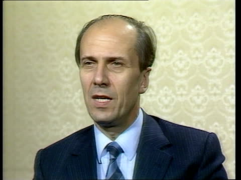nissan sign deal to build car plant in britain; england: london: int norman tebbit mp 2 way interview sof tx'd 1.2.84/c4n archive tape no 19862... - ピーター・シソンズ点の映像素材/bロール