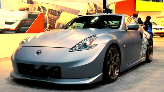 "nissan sign; front three-quarter passenger side view of project 370z car / headlight; front three-quarter driver side view / z"" badge; driver side... - matte finish stock videos & royalty-free footage"