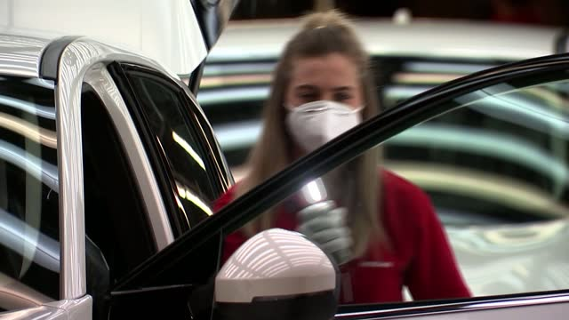 nissan to build car battery factory and new electric vehicles in sunderland; england: sunderland: nissan plant: int gv workers checking nissan car in... - power supply stock videos & royalty-free footage