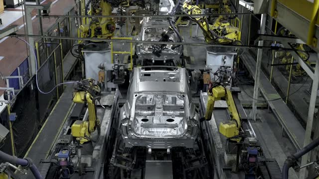nissan to build car battery factory and new electric vehicles in sunderland; england: sunderland: nissan plant: int gv mechanic working on car... - turning stock videos & royalty-free footage
