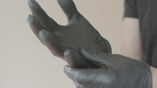 nitrile surgical gloves for covid-19 protection - organisation stock videos & royalty-free footage