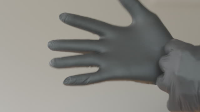 nitrile surgical gloves for covid-19 protection - sicurezza video stock e b–roll