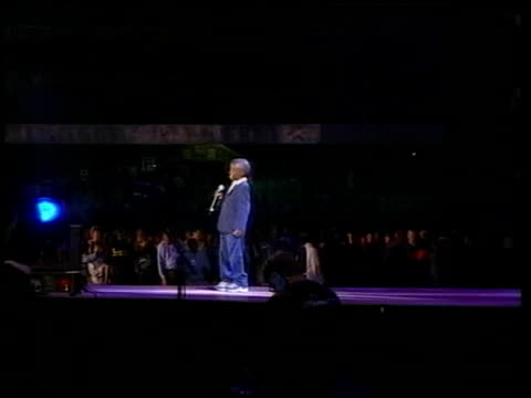 nkosi johnson funeral lib durban night lms side nkosi johnson on stage speaking at world aids conference mother gail watching gv audience nkosi... - nkosi johnson stock videos & royalty-free footage
