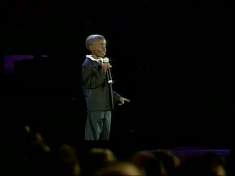 nkosi johnson funeral south africa nkosi johnson funeral lib durban nkosi johnson on stage speaking at world aids conference woman watching nkosi... - nkosi johnson stock videos & royalty-free footage