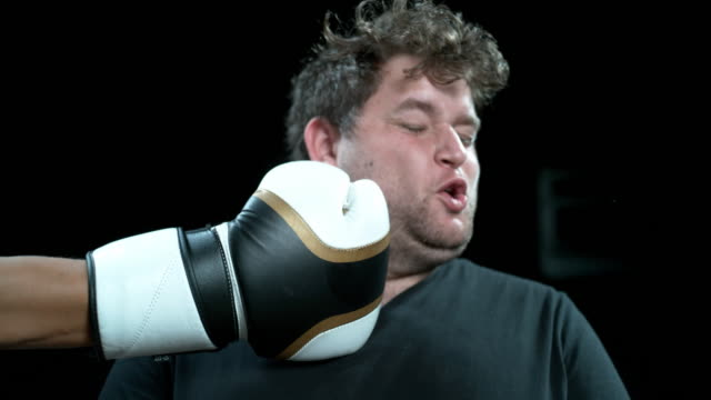 no amount of punches will stop me from smiling - punching stock videos & royalty-free footage