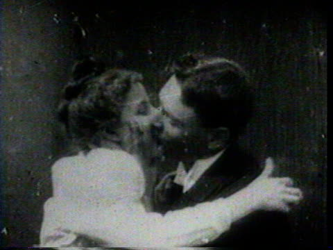 No Audio / Early Motion Picture footage / Man and Woman kiss for the camera /