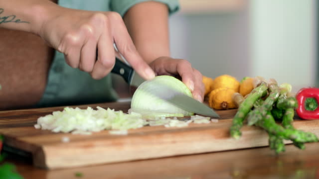 no crying with these onions - chopped stock videos and b-roll footage