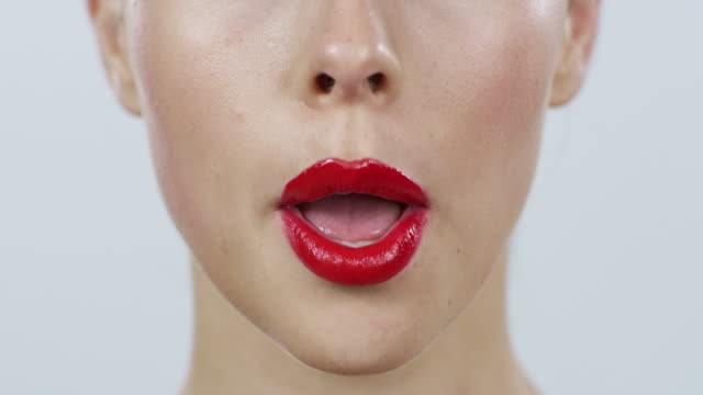 no doubt, red lipstick does wonders for your pout - lipstick stock videos & royalty-free footage