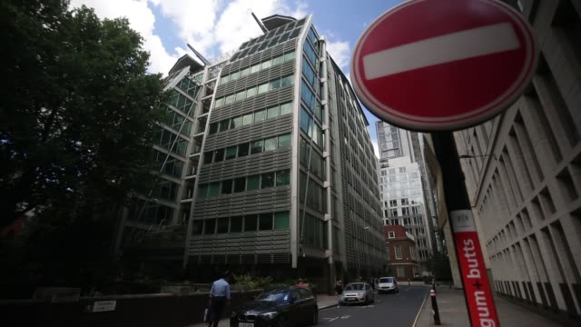 a 'no entry' road traffic sign stands outside lloyds banking group plc's headquarters in london uk on monday aug 12 tilt up from garden to lloyds... - plc stock videos & royalty-free footage