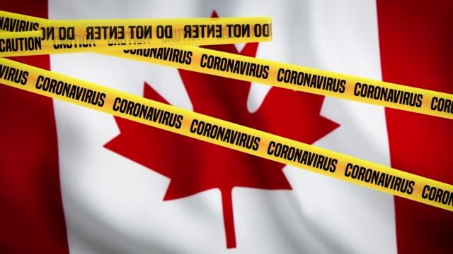 vídeos de stock e filmes b-roll de no entry tapes are on the flag of canada. it is forbidden to enter due to coronavirus outbreak. - bandeira do canadá