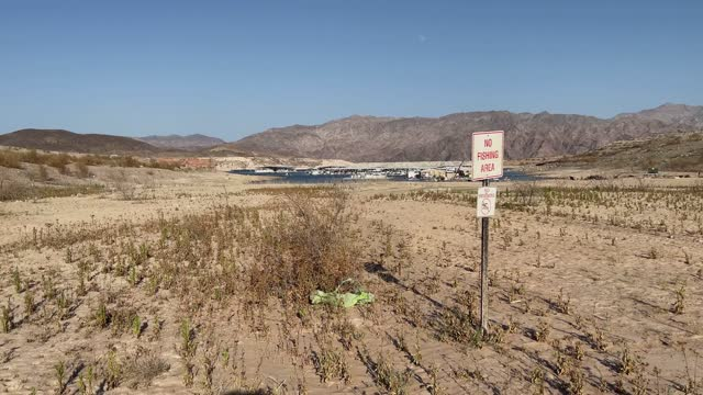 """no fishing area"""" sign and a """"no swimming"""" sign are posted in an area once underwater at the callville bay marina on june 21, 2021 in the lake mead... - western usa stock videos & royalty-free footage"""