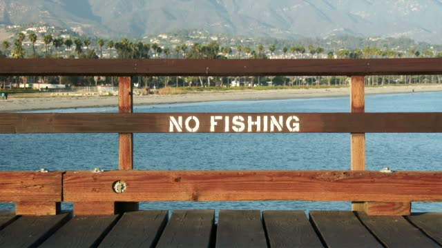 no fishing sign painted on pier - pier stock videos & royalty-free footage