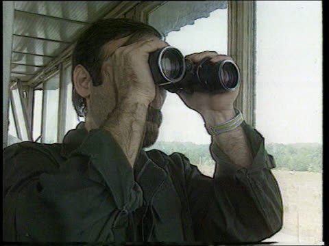 un no fly'' zone ext location unknown barge along danube river int barge cms sailor looking through pair of binoculars ext lms barge along river pan... - river danube video stock e b–roll