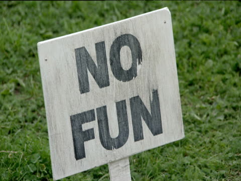 'no fun' sign in grass mile end park london - natural parkland stock videos & royalty-free footage