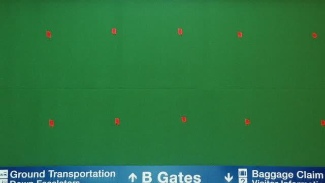 stockvideo's en b-roll-footage met no information is displayed on an airport flight information monitor. - onbeschreven