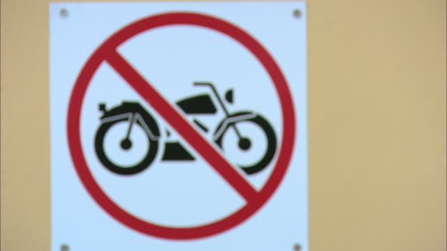 cu no motorcycles sign on display - bokeh museum stock-videos und b-roll-filmmaterial