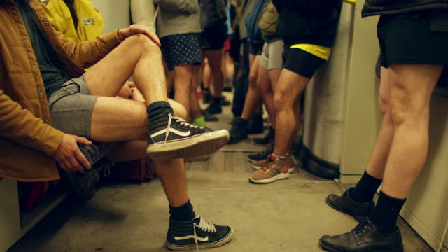 no pants day subway ride in berlin flashmob art - shorts stock videos & royalty-free footage