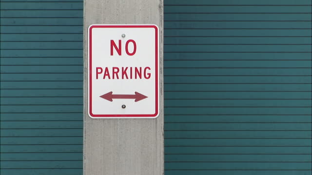 "cu, zo, ""no parking"" sign between garage doors - no parking sign stock videos & royalty-free footage"