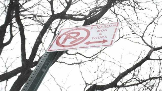 no parking street sign in a blizzard - no parking sign stock videos & royalty-free footage