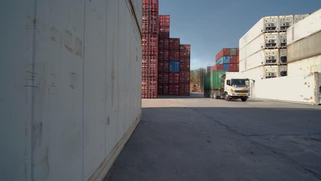 no people, logistics and transportation of container cargo in dock ship.transport/industry concept. - transportmedel bildbanksvideor och videomaterial från bakom kulisserna