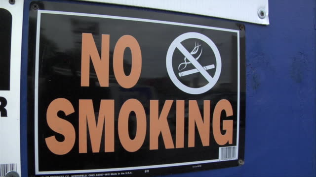 cu 'no smoking' sign bolted to blue wall / new york, new york, usa - no smoking sign stock videos & royalty-free footage