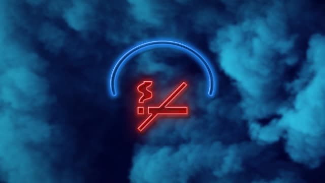 no smoking sign on neon light against blue background in 4k resolution - no smoking sign stock videos & royalty-free footage