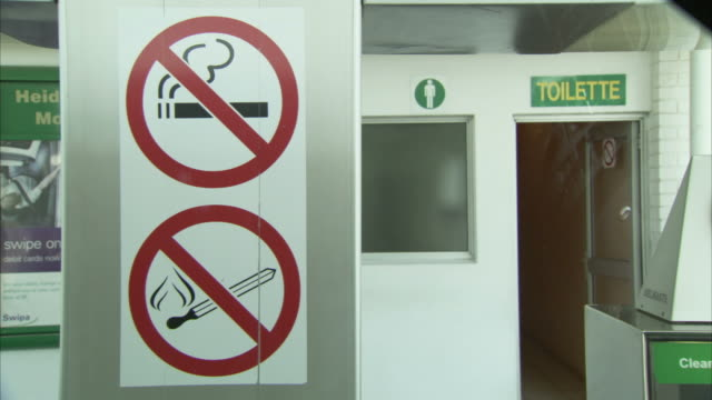 no smoking signs beside a toilet at a petrol station. - bathroom stock videos & royalty-free footage