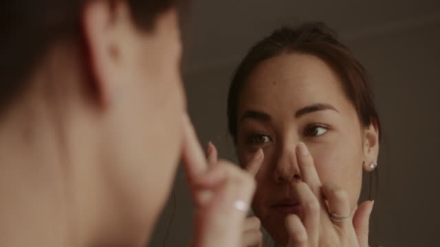 no under eye circles? check - skin feature stock videos & royalty-free footage