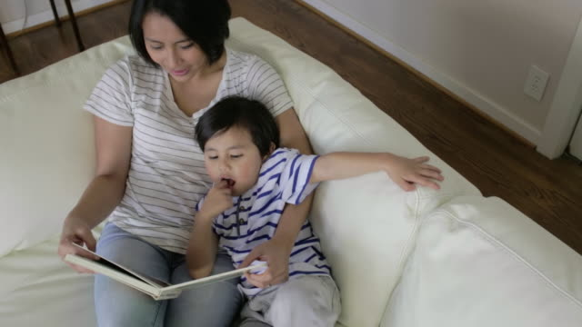 noah & chustine at ross home - picture book stock videos and b-roll footage