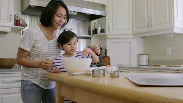noah & chustine at ross home - cooking crack in a spoon stock videos & royalty-free footage