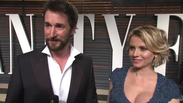 interview noah wyle sara wells and at the 2015 vanity fair oscar party hosted by graydon carter at the wallis annenberg center for the performing... - wallis annenberg center for the performing arts stock videos and b-roll footage