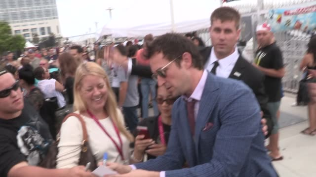 noah wyle sara wells greet fans while departing the 2014 comic con panel in san diego in celebrity sightings in san diego - noah wyle stock videos and b-roll footage