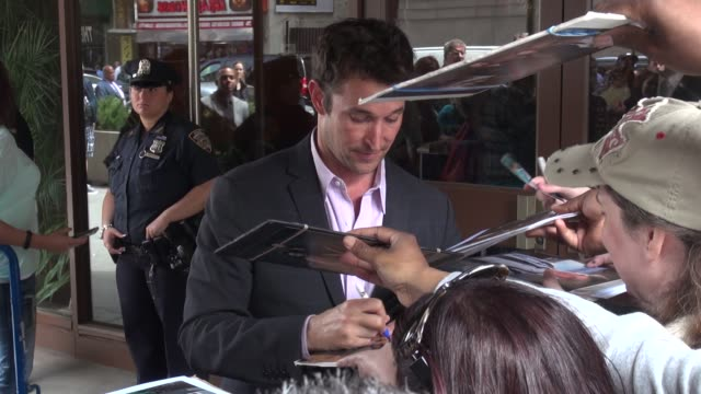 noah wyle signs for fans outside of the theater at madison square garden for the tnttbs upfront in celebrity sightings in new york - noah wyle stock videos and b-roll footage
