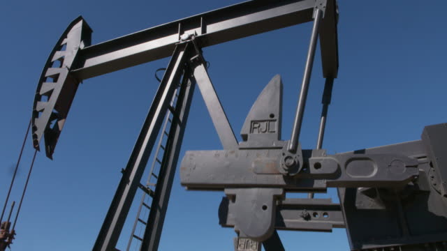 'nodding donkey' oil well in los angeles - machine part stock videos & royalty-free footage