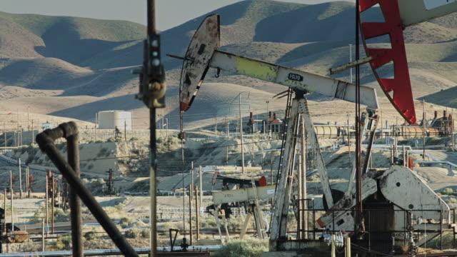 nodding donkeys in oil field - oil industry stock videos & royalty-free footage