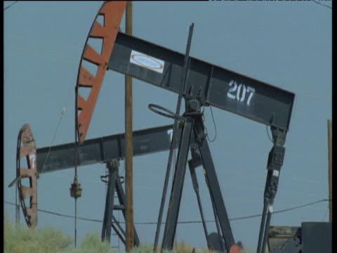 Nodding donkeys pump oil, Bakersfield, California